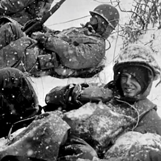 An old black and white picture of active duty Marines in the snow