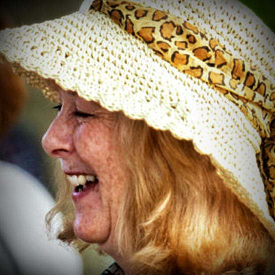 Beautiful middle-aged woman smiling in a sunhat