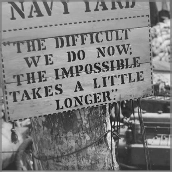 black and white Seabees sign reads - the difficult we do now - the impossible takes a little longer