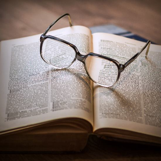 reading glasses on an open book