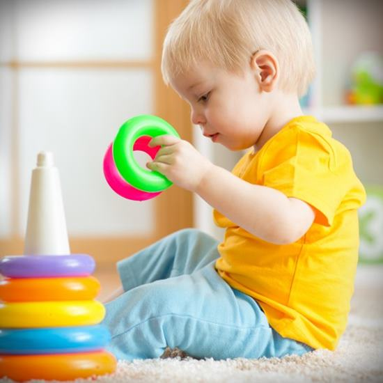 Child playing with plastic rings