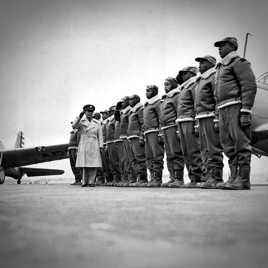 Line of Tuskagee Airmen in black and white photo