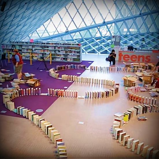 inside a library with book dominos