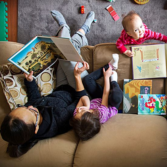 Family reading on the couch