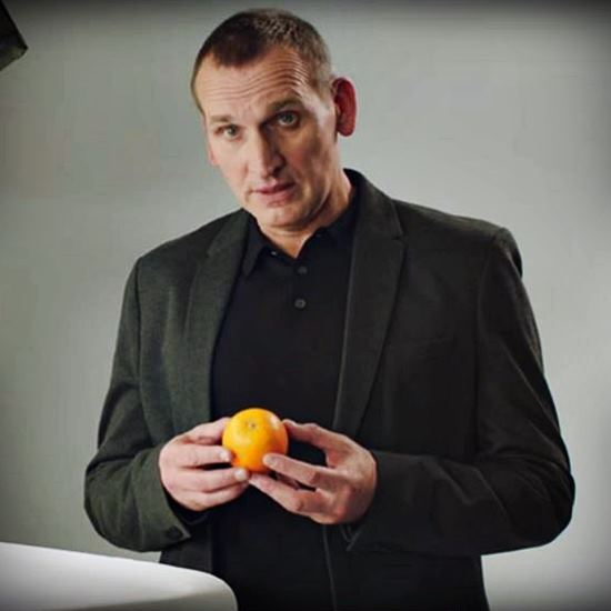 Chris Eccleston holding an orange