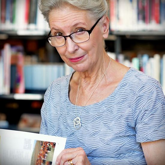 Elderly woman with a book