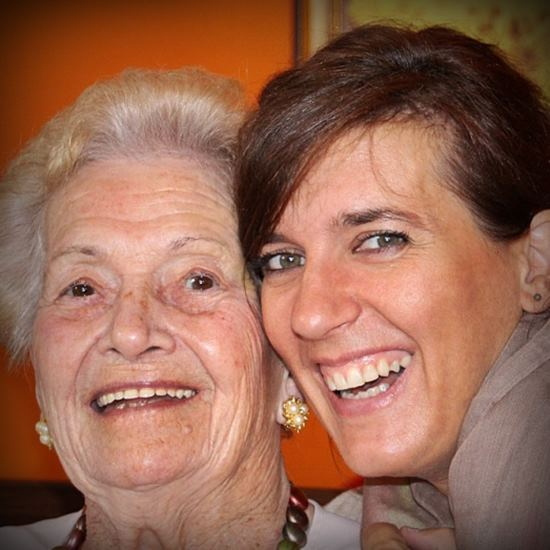 Middle-aged woman smiling with senior woman