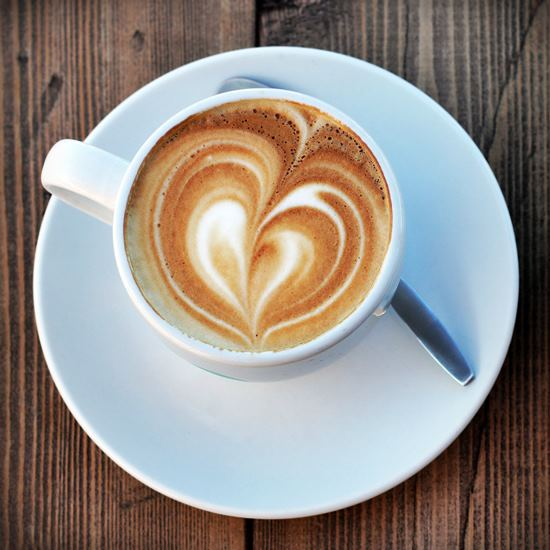 Latte with lovely foam art heart