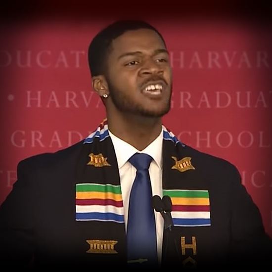 Young man in Harvard graduation reading his own inspiring poetry