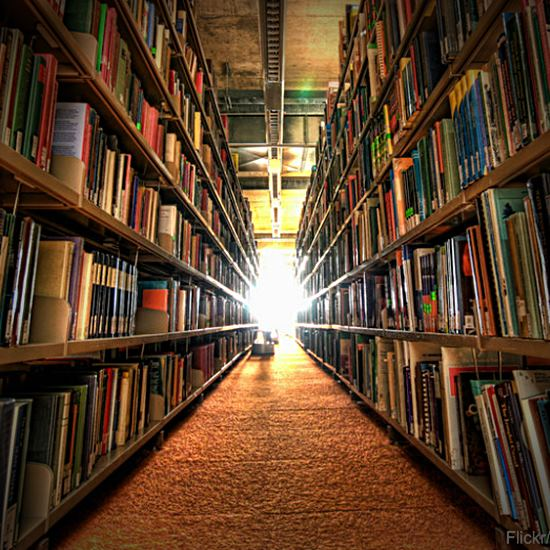 Library stacks going on forever into the light