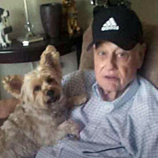 Elderly man with a small dog