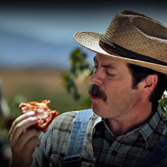 Farmer in the field with a fresh-picked slide of pizza
