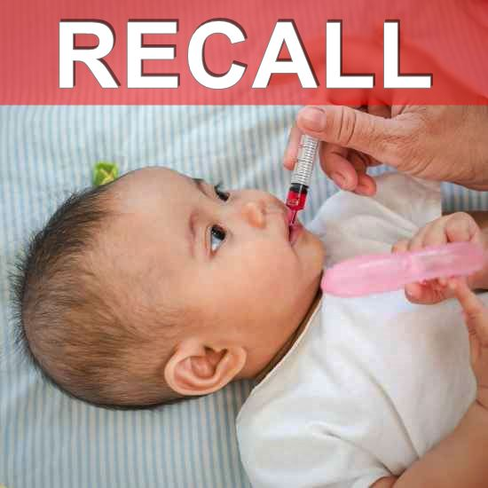 Baby getting medicine - recall banner overlaid