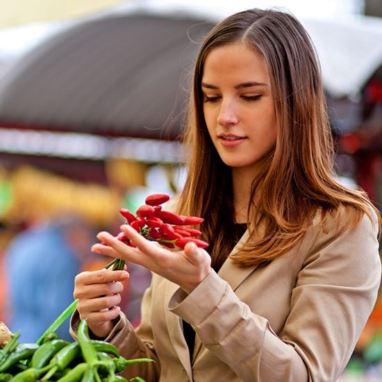 Woman inspecting lovely produce