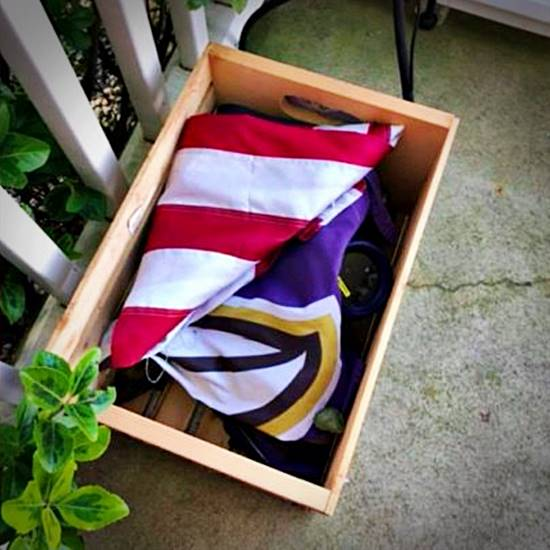 folded flags in a box