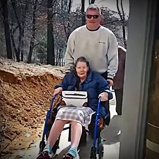 Elderly woman in wheelchair is surprised