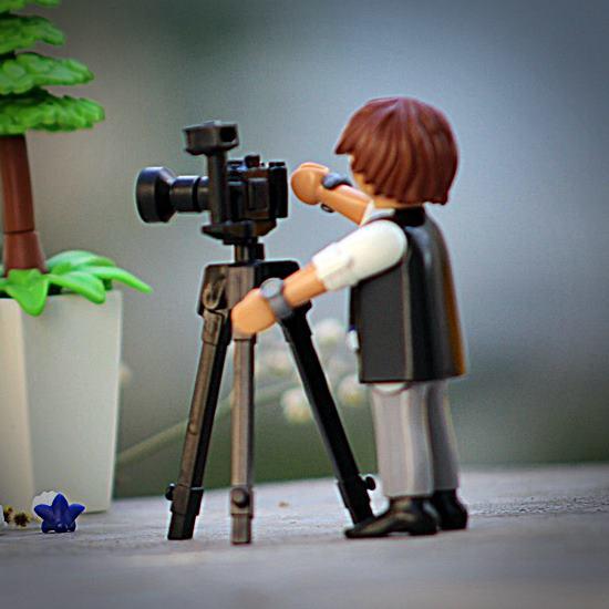 Lego cameraman with camera on tripod
