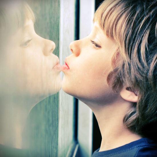 Boy leaning against a window