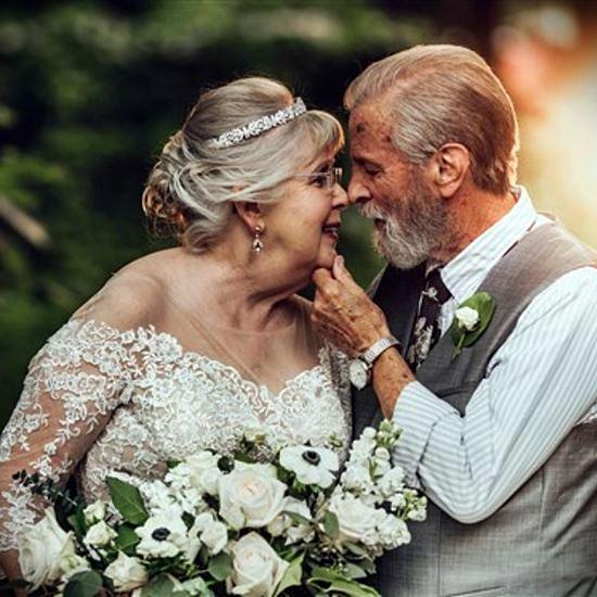 Beautiful senior couple in wedding regalia for 60th anniversary