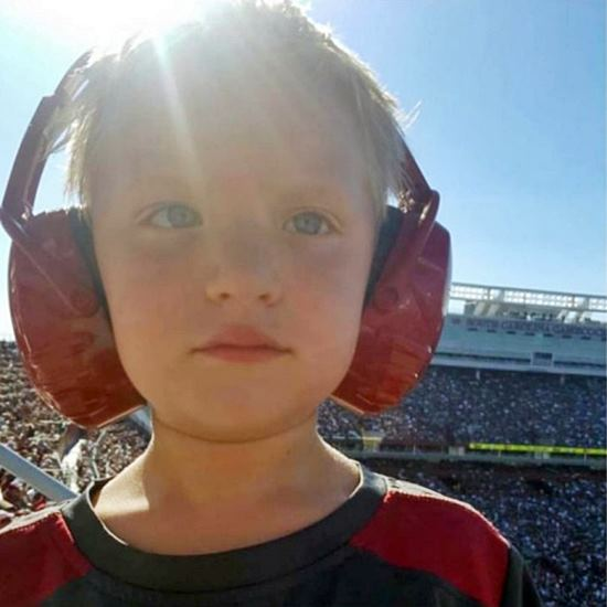 Child with noise-cancelling headphones on