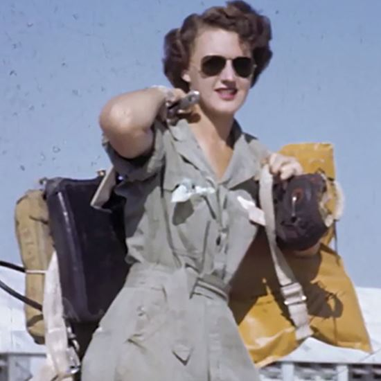 Woman in sunglasses disembarking from an aircraft