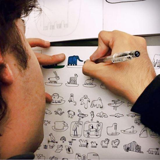 Man creating pen sketches