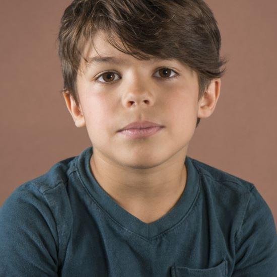 Boy with intense brown eyes