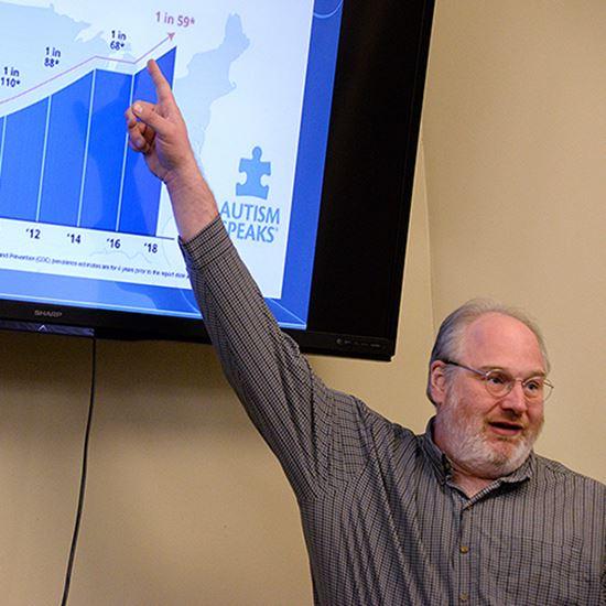 Man pointing at chart