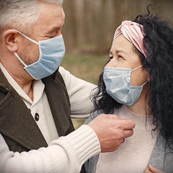 Man and girl with face masks on