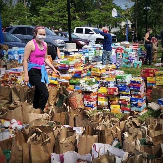 Community members with boxes and bags of donations