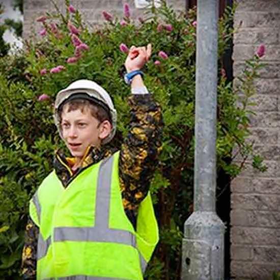 Boy in construction safety gear