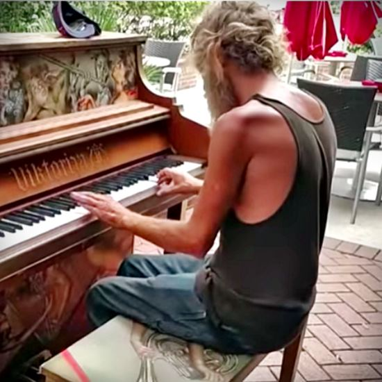 Ex-marine playing decorated street piano