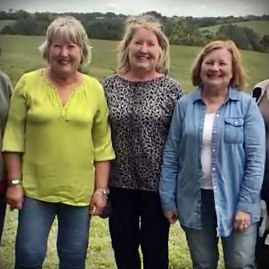 Beautiful middle aged women smiling for camera