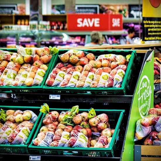 Apples in produce section of grocery store