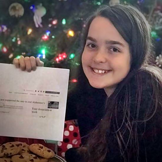 Smiling girl with donation check